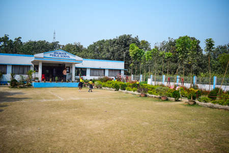 Malda, India- February 2nd, 2019: A kindergarten school building with a playground in front of it