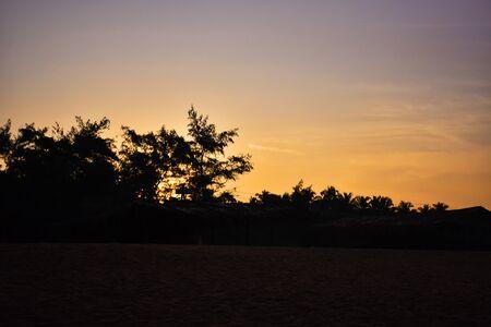 a beautiful yellowish sunset in goa beach