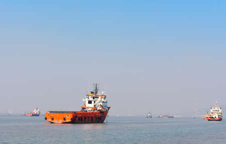 A single boat ,moving towards its destination in this big blue ocean