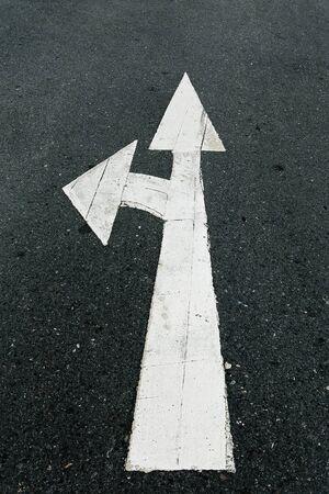 A close up on an arrow on pavement