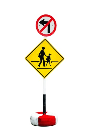 Traffic sign prohibiting a left turn, the people across the street  Stock Photo