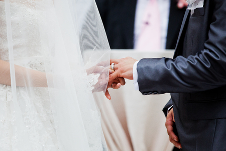 wedding vows: The bride dresses a wedding ring to the groom Stock Photo
