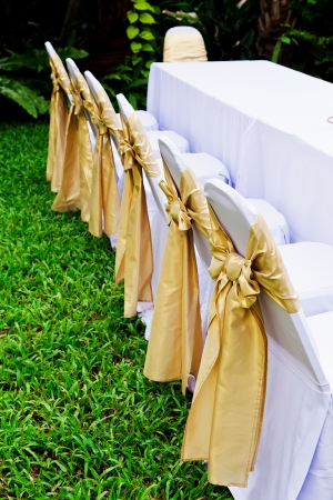 The back of yellow and gold wedding chairs