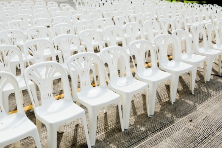 White plastic chairs in celebration and outdoor event Stock Photo