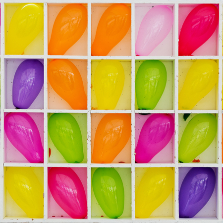 Holiday background with colorful balloons and box