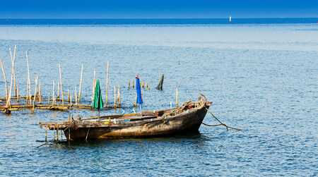 commercial fishing net: Small fishing boats in the sea