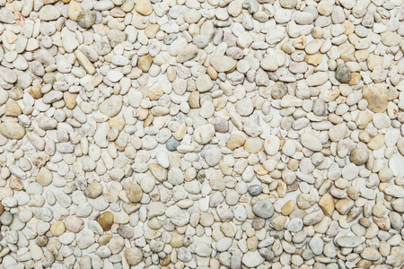 Small naturally polished white rock pebbles background Stock Photo