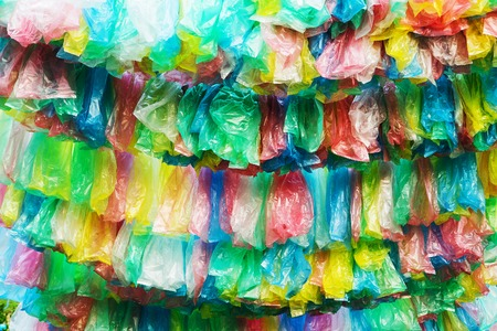 Crumpled garbage bag then put into a beautiful background  photo