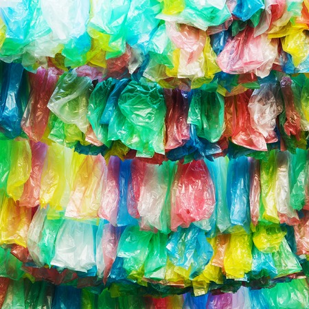 Crumpled garbage bag then put into a beautiful background  Stock Photo