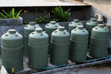 Large eco- friendly water storage tank in suburban backyard photo