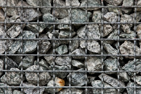 Stone paving stones of granite in a steel container photo
