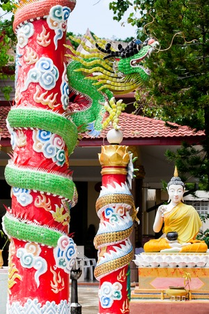 a big dragon statue at thailand,chinese temple  photo
