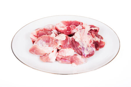 Fresh damp meat on plate insulated on white background Stock Photo