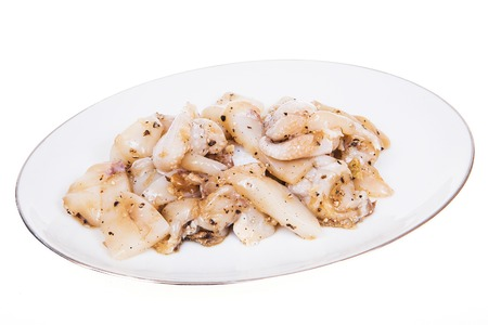 Squid marinated with garlic, pepper, sliced