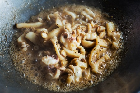 Squid with garlic and pepper in a saucepan and Thailand
