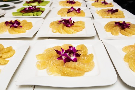 pomelo slices on dish in pyramid shape photo