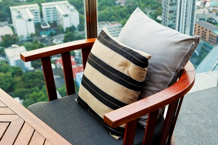 Wooden sofa in the lounge a garden setting. photo