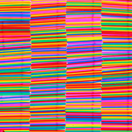arranged: Tube with various colors arranged as background.