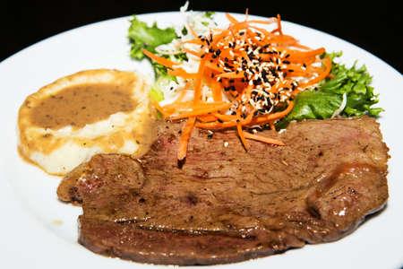 Fried pork chop, mashed potato and vegetable salad Stock Photo