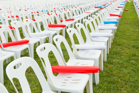 outdoor event: White plastic chairs in celebration and outdoor event Stock Photo