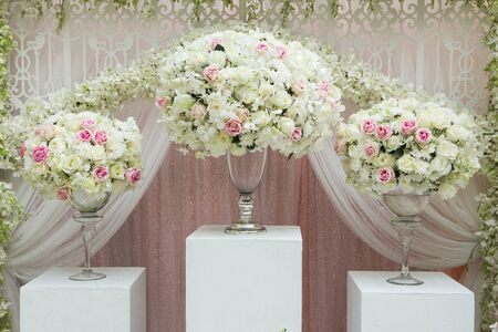 wedding table decor: flower arrangement in silver bowl with pink and white roses Stock Photo