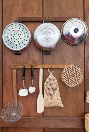 old style kitchenware in Thailand on wood wall