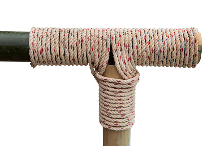 tied knot: Rope tied knot at bamboo wood on a white background. Stock Photo