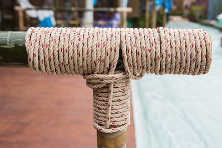 tied knot: Rope tied knot at bamboo wood