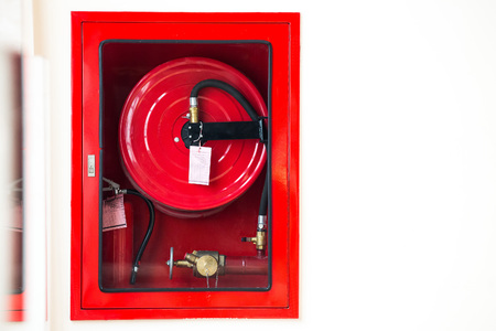 smother: Fire safety equipment in the red box on wall cement