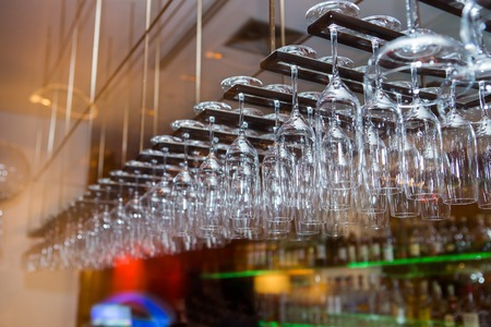 bocal: Glasses hanged over the bar table