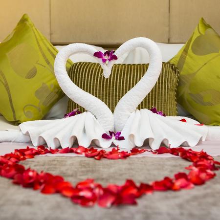 honey moon: towel swans shaped on luxury bed,Honey moon bed