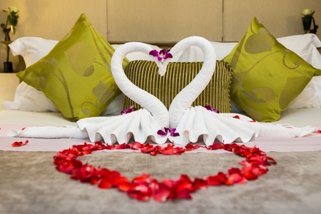 towel swans shaped on luxury bed,Honey moon bed