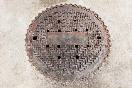manhole cover: Manhole cover on the brick ground floor Stock Photo