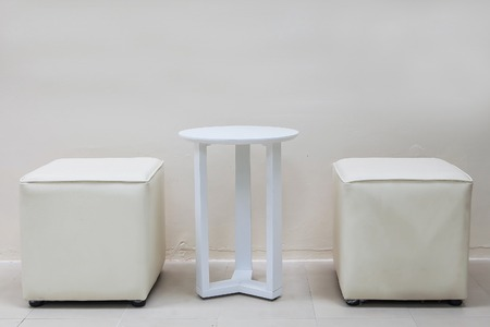 elbowchair: White table and white stools in white room
