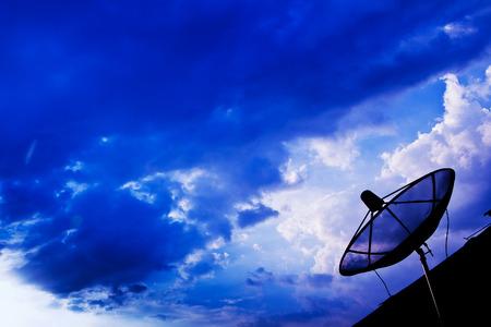 bandwidth: Satellite dish sky sunset communication technology network Stock Photo