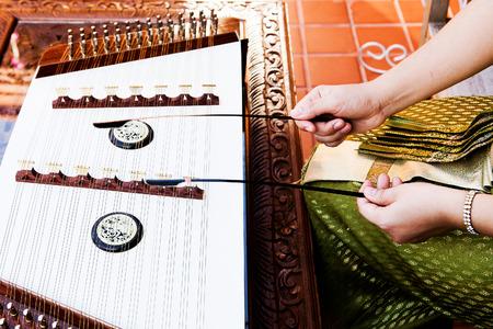 thai musical instrument: hand play dulcimer, music instrument,Thai wooden dulcimer musical instrument Stock Photo