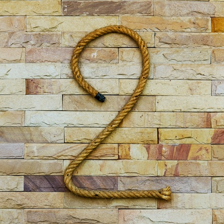 periodical: Rope Number two Alphabet on stone background