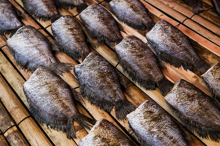 fish vendor: Fishes (Trichogaster pectoralis) arrange on rattan in market Stock Photo