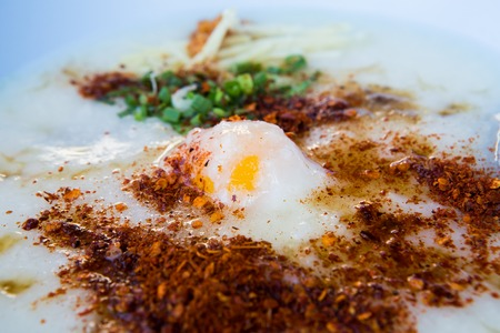 Congee with pork and boiled egg
