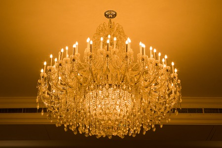 cutglass: shot of Home interiors Chandelier on ceiling Stock Photo