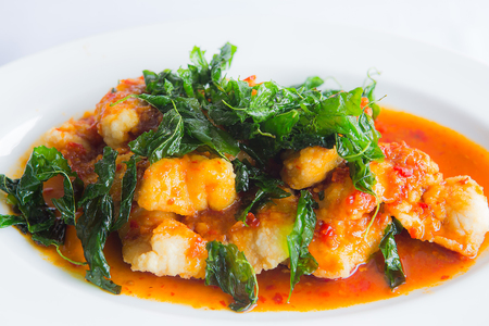 Close up deep fried grouper fish spicy sweet and sour sauce Stock Photo