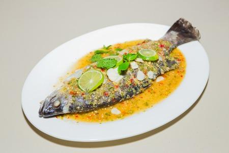 Steamed Fish in Lemon Sauce on white plate