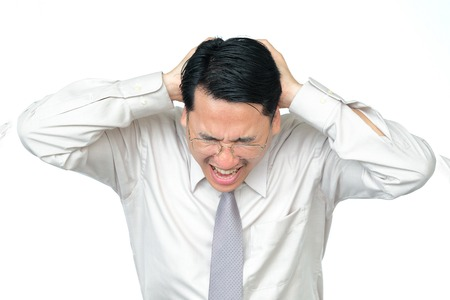 fearful: Businessman with headache, white background Stock Photo
