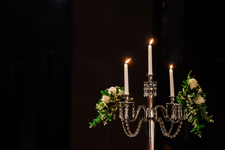 Wedding candle and  bride groom in ceremony