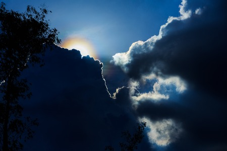 dramatic cloud sunset time with sunbeams, sun rays in the sky Imagens