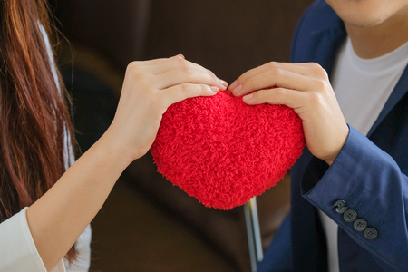 Valentine's Day man gave the red heart to girl to show love. Banco de Imagens
