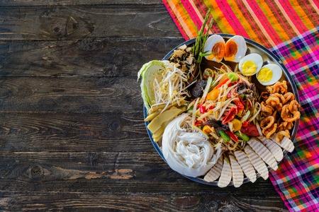 Som tum or papaya salad on dark table background. Thai food concept 스톡 콘텐츠