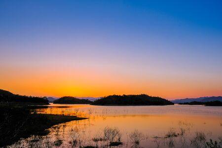 Sunset at lake, Kaeng Krachan Dam on Silhouette