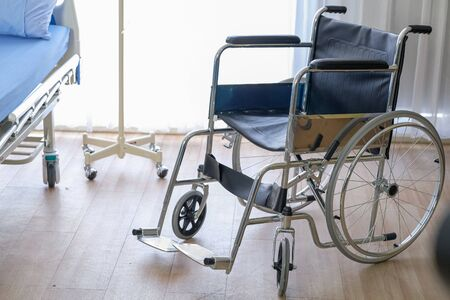 Medical theme: a wheel chair in a hospital. Stockfoto