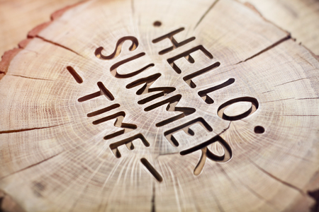 summertime: Hello summer time decorative wood carving, background. positive quote for design. Hand lettering inspirational typography poster, photo banner.